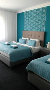 Postel nebo postele na pokoji v ubytování Villa Kiwi