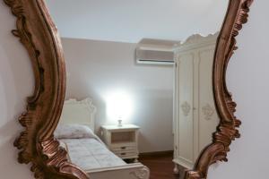 Letto o letti in una camera di La Dimora di Lara B&B