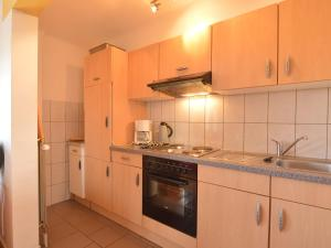 A kitchen or kitchenette at Captivating Apartment in Halenfeld-Amel with Terrace