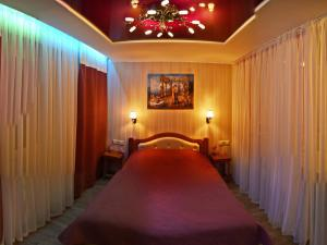 A bed or beds in a room at ApartLux Chernigov