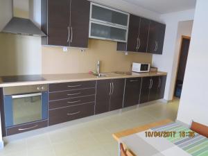 A kitchen or kitchenette at Casas do Zé Vila