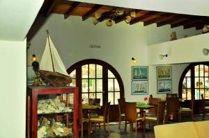 A restaurant or other place to eat at Portiani Hotel