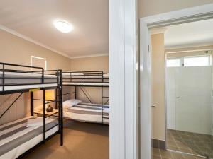 A bunk bed or bunk beds in a room at RAC Cervantes Holiday Park