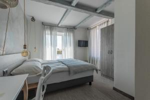 A bed or beds in a room at Seven Boutique Hotel