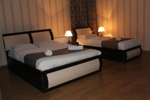 A bed or beds in a room at Hotel Elegant