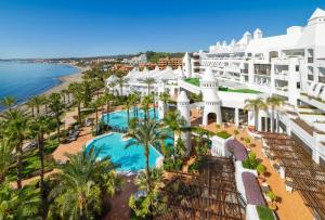 A view of the pool at H10 Estepona Palace or nearby