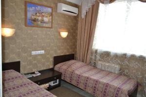 Кровать или кровати в номере Отель Олимп