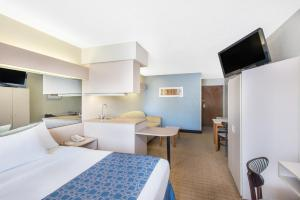 A television and/or entertainment center at Microtel Inn & Suites by Wyndham