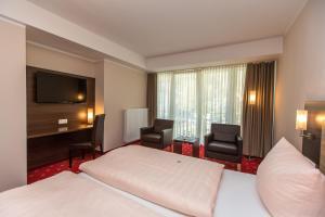Een bed of bedden in een kamer bij Parkhotel Cochem