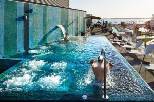 A piscina em ou perto de Hotel Faro & Beach Club