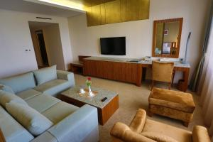 A seating area at Shangria Beach Tourist Hotel