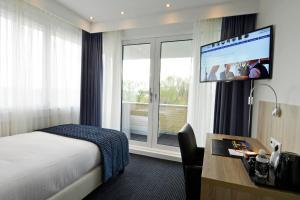 Een TV en/of entertainmentcenter bij Hotel De Zoete Inval Haarlemmerliede