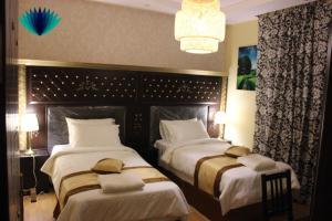 Cama ou camas em um quarto em Tafasel Aparthotel