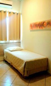 Cama ou camas em um quarto em Hotel Eden