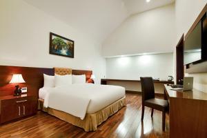 Giường trong phòng chung tại Ebisu Onsen Resort