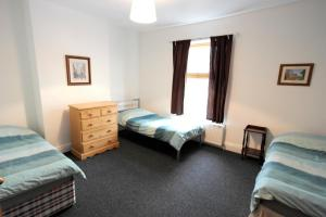 A bed or beds in a room at Holland Road