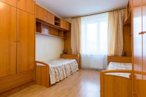 A bed or beds in a room at Stylish Europa near Moscow City