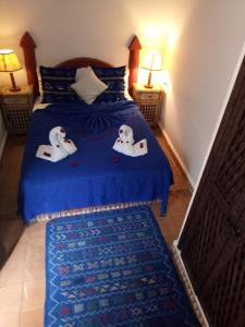 A bed or beds in a room at Riad Chakir Mogador