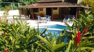 The swimming pool at or near Pousada Mareilha