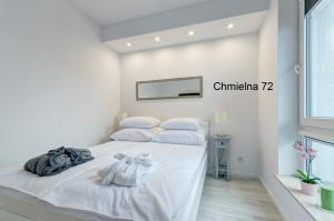 Łóżko lub łóżka w pokoju w obiekcie Twój Salon-Apartamenty Stare Miasto