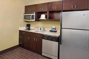 A kitchen or kitchenette at Homewood Suites Dallas Downtown