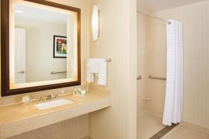 A bathroom at Homewood Suites Dallas Downtown