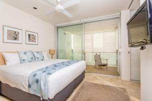 A bed or beds in a room at Plantation Resort At Rainbow