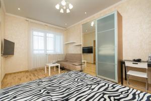 Кровать или кровати в номере Апартаменты Золотая Подкова 110в