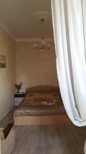 Кровать или кровати в номере Apartment Первомайский 7