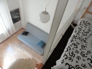 Кровать или кровати в номере Liteyny-60