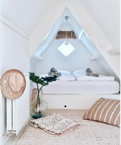 Un ou plusieurs lits dans un hébergement de l'établissement ELSK Cottage