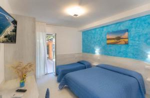A bed or beds in a room at Affittacamere I Principi del Conero