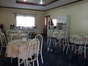 A restaurant or other place to eat at Dominique Hotel