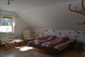 A seating area at B&B Prosterath-Hochwald