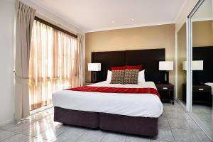 A bed or beds in a room at BreakFree Aanuka Beach Resort