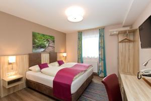 Ein Bett oder Betten in einem Zimmer der Unterkunft Hotel Das Junior by MAX 70
