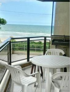 A balcony or terrace at Apartamento Confortável Saída Praia