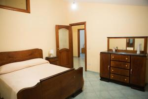 A bed or beds in a room at La Rimessa