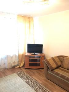 Телевизор и/или развлекательный центр в Apartment G-Kvartal Alekseevskaya