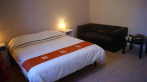 A bed or beds in a room at B&B Vegan Inn Airport - Adult Only