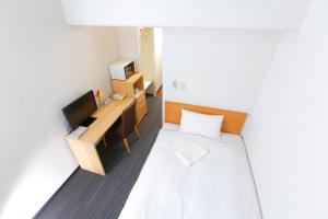 A bed or beds in a room at FLEXSTAY INN Tokiwadai