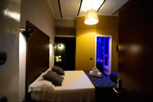 A bed or beds in a room at Hotel Felice