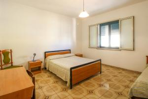 A bed or beds in a room at Grandi Appartamenti Centrali