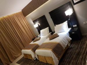Cama ou camas em um quarto em Al-Hariri Suites