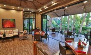 A restaurant or other place to eat at Tahiti Village Resort & Spa