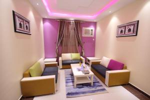 Uma área de estar em Nakheel Moon Aparthotel