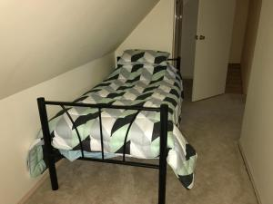 A bed or beds in a room at 91 Stevenson Court