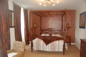 A bed or beds in a room at La Villa Champagne Ployez-Jacquemart