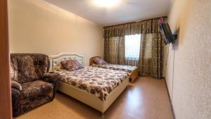 Кровать или кровати в номере Apartments at Michurina 15