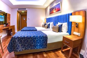 Ein Bett oder Betten in einem Zimmer der Unterkunft Liberty Hotels Lara